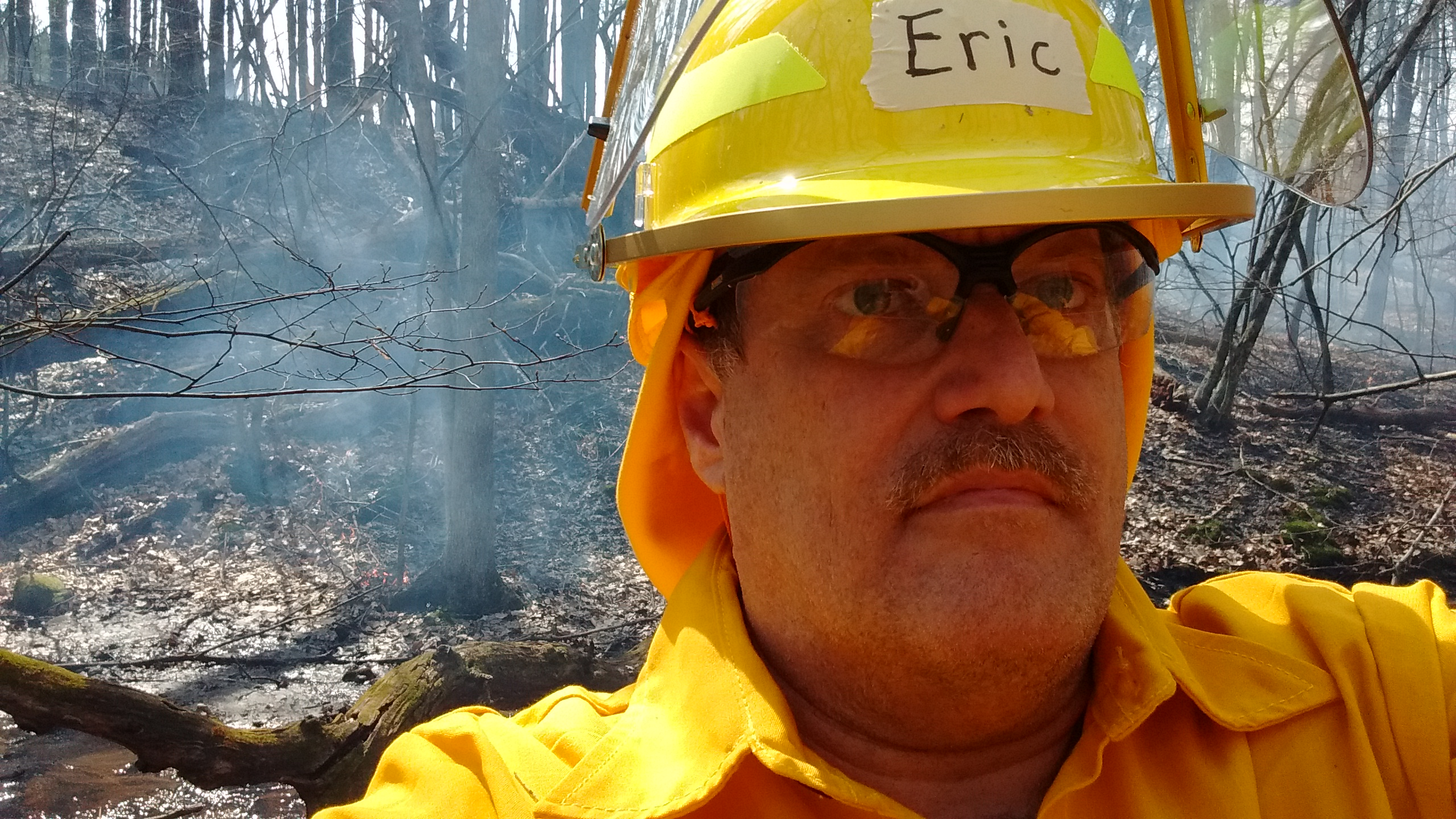 see larger photo of author working a prescribed burn